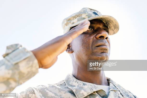 black soldier saluting - saluting stock pictures, royalty-free photos & images