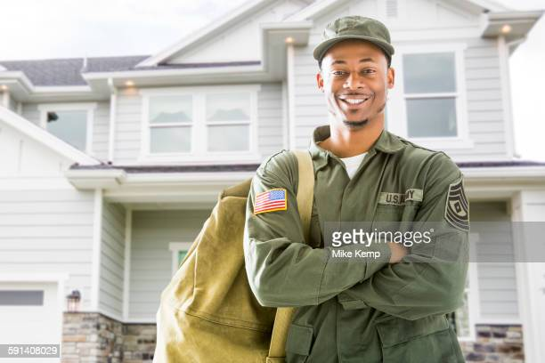 black soldier standing outside house - marines military stock pictures, royalty-free photos & images