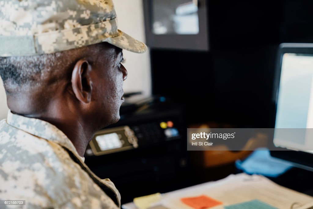 Black soldier using computer : Stock Photo