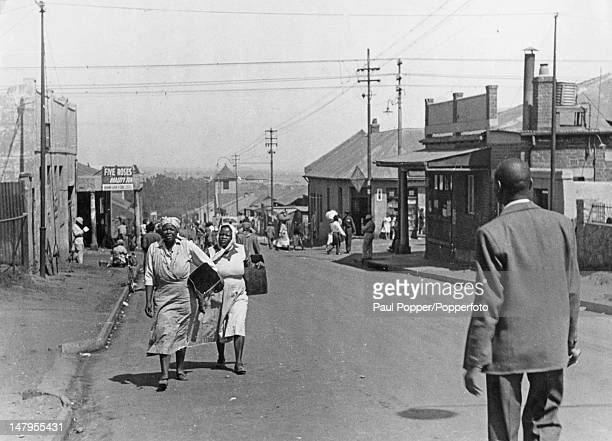 Black South Africans on Toby Street Johannesburg South Africa circa 1950 The street divides the black suburb of Sophiatown from the white...