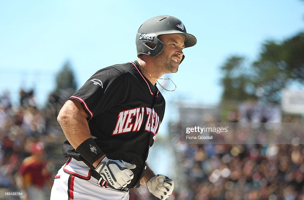 Black Sox captain Rhys Casley celebrates a home run during the gold medal match between New Zealand and Venezuela at Tradstaff Sports Stadium on March 10, 2013 in Auckland, New Zealand.
