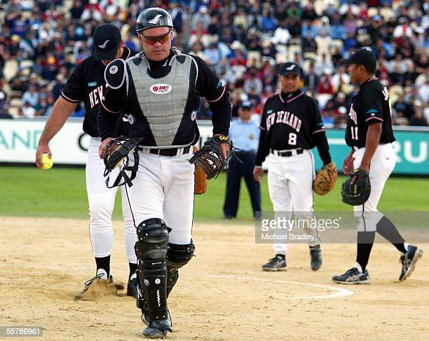 Black sox Mark Sorenson walks back to the home plate during the final between The New Zealand Black sox and Team Canada at the World Softball Champs...