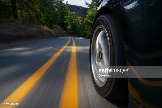 black sports car motion country road. - domestic car stock pictures, royalty-free photos & images