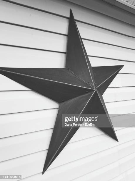 black star on white wall - dana white stock pictures, royalty-free photos & images
