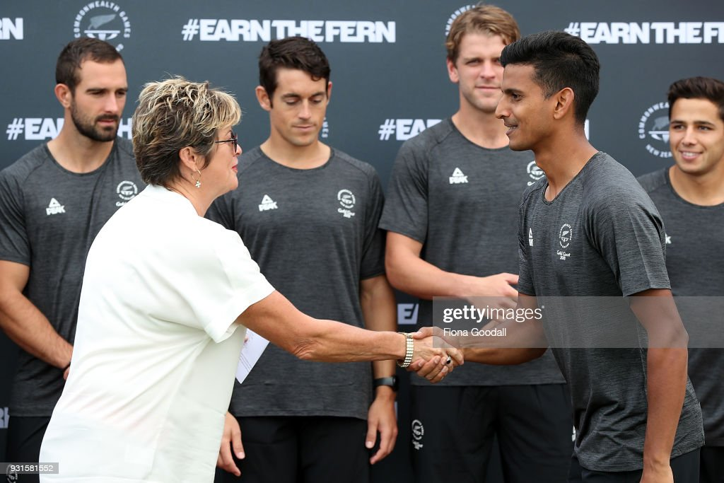 Black Sticks captain Jared Panchia is congratulated by NZOC CEO Kereyn Smith (L) during the New Zealand Commonwealth Games Men's Hockey Team Selection Announcement at Harbour Hockey on March 14, 2018 in Auckland, New Zealand.