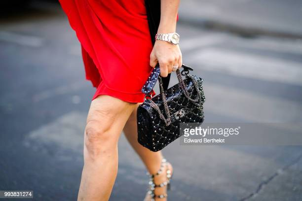 Black studded Valentino bag , outside Valentino, during Paris Fashion Week Haute Couture Fall Winter 2018/2019, on July 4, 2018 in Paris, France.