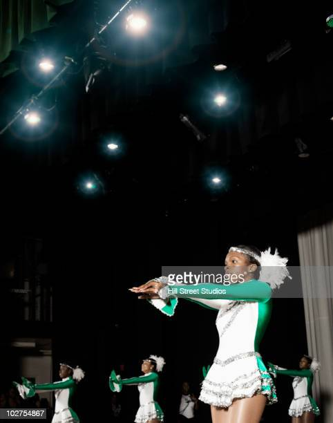 black student dance team performing on stage - black cheerleaders stock photos and pictures