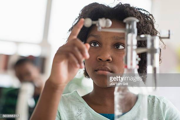 Black student doing experiment in science lab