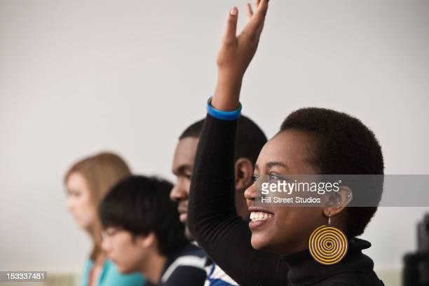 black student raising hand in computer lab - caldwell idaho foto e immagini stock