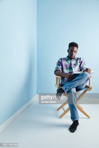 black student reading - director's chair stock pictures, royalty-free photos & images