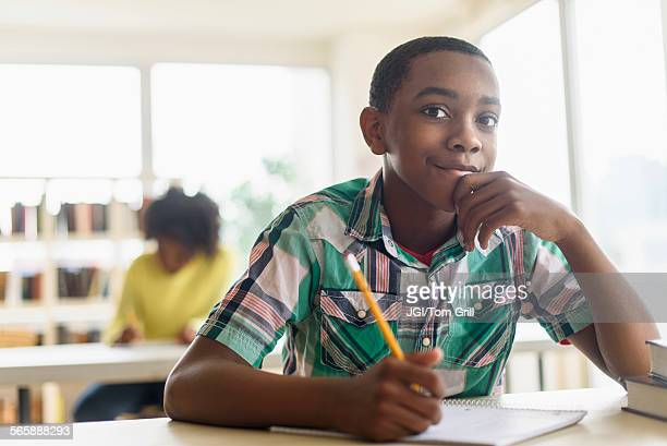 Black student thinking in classroom