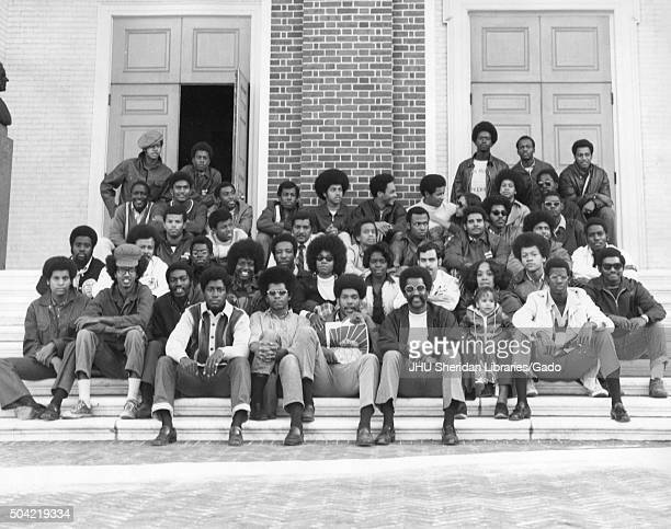 Black Student Union group photo sitting on stairs of a building at Johns Hopkins University, 2001. .