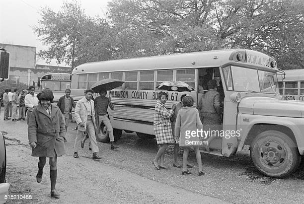 """Black students in Woodville, Mississippi board a school bus for their first day at a formerly white school that, thanks to """"white flight"""", has become..."""