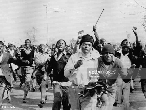 Black students protesting against the compulsory teaching of Dutchbased Afrikaans in black schools charge during a riot in Soweto Police opened fire...