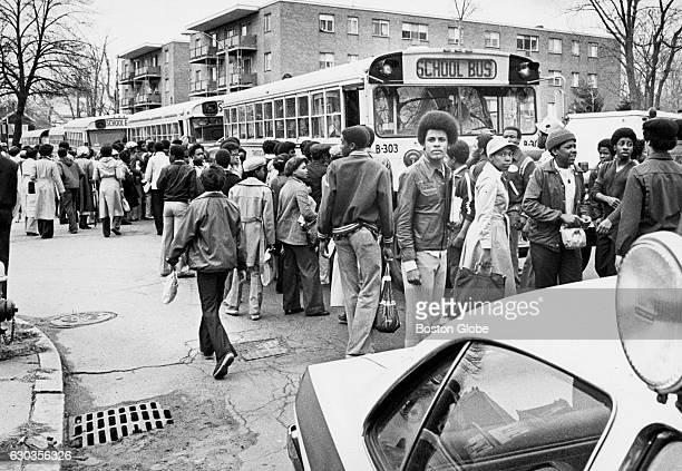 Black students wait to board buses on River Street in Mattapan after walking out of Hyde Park High School in Boston on the morning of April 11 1978...