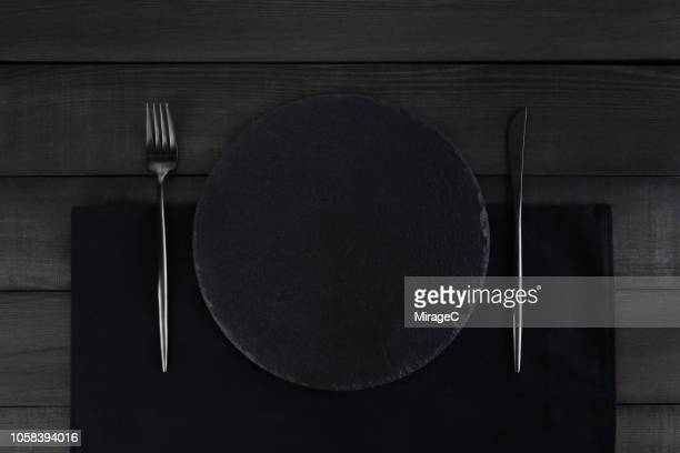 black style table setting - miragec stock pictures, royalty-free photos & images