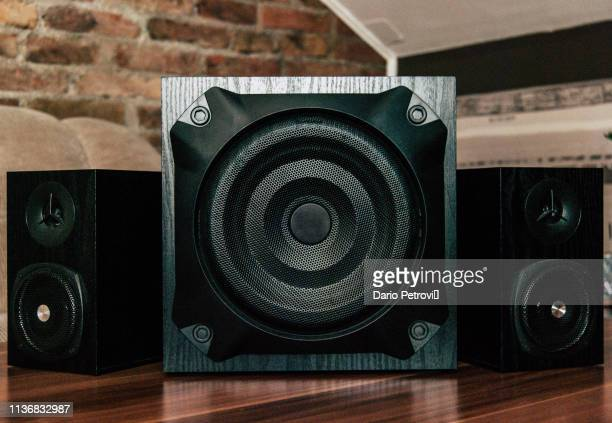 black sub-woofer and two speakers - membrane stock photos and pictures