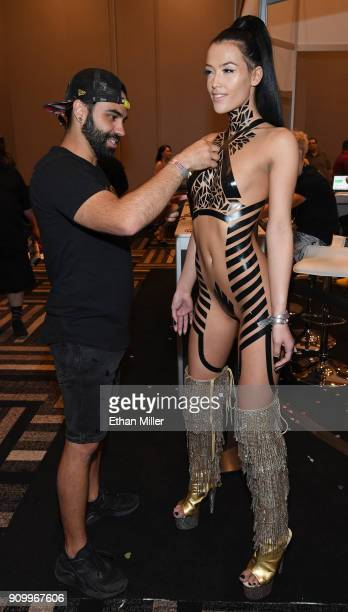 Black Tape Project creator Joel Alvarez uses pieces of black electric tape to create an artistic fashion look on webcam model London Bunny at the...