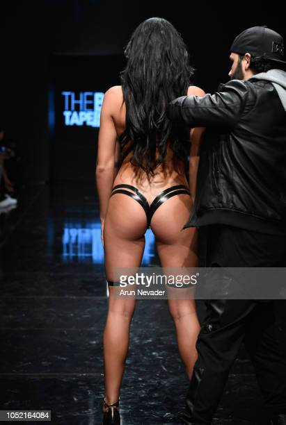 Black Tape Project designer Joel Alvarez doing live fashion on the runway with a model at Los Angeles Fashion Week Powered by Art Hearts Fashion LAFW...