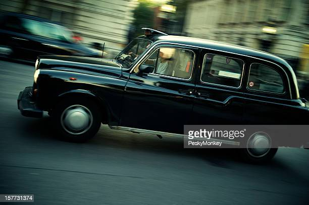 Black Taxi Drives on London Street