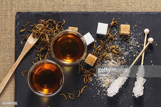 Black Tea and Sugar on Rustic Stone Tray
