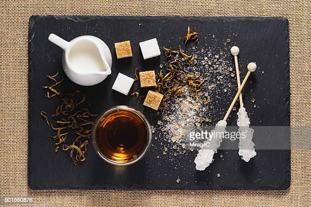 Black Tea, Cream and Sugar on Rustic Stone Tray