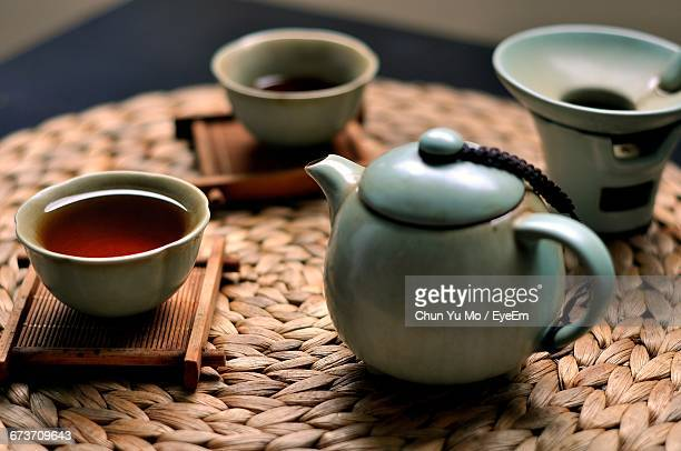 Black Tea In Cup With Teapot