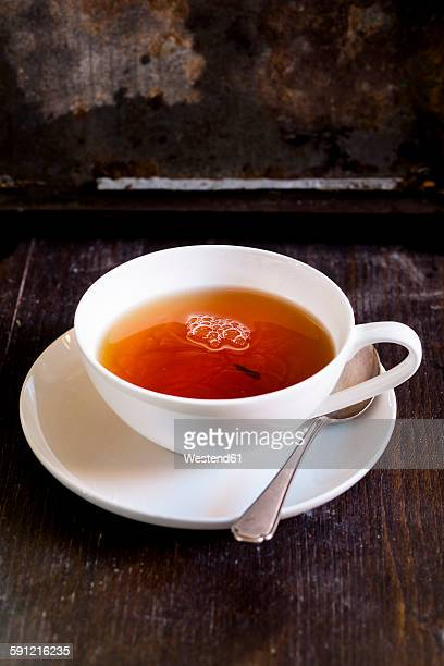 black tea in white porcellain cup - tea cup stock pictures, royalty-free photos & images