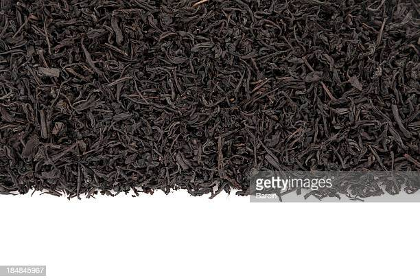 black tea leaves - tea leaves stock photos and pictures