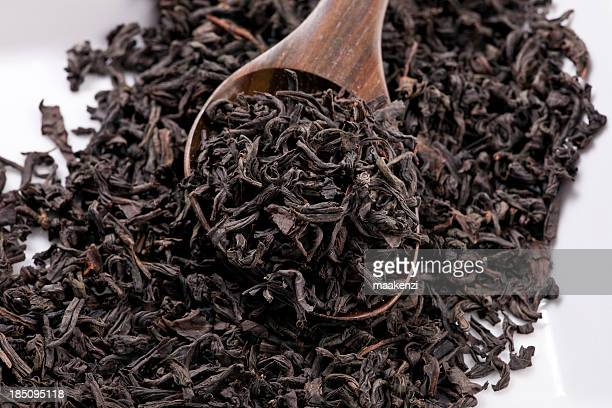 black tea - tea leaves stock photos and pictures