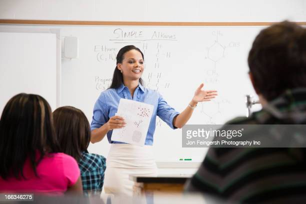 black teacher talking to students in class room - education stock pictures, royalty-free photos & images