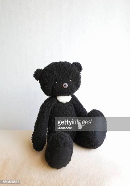 black teddy bear - ぬいぐるみ ストックフォトと画像