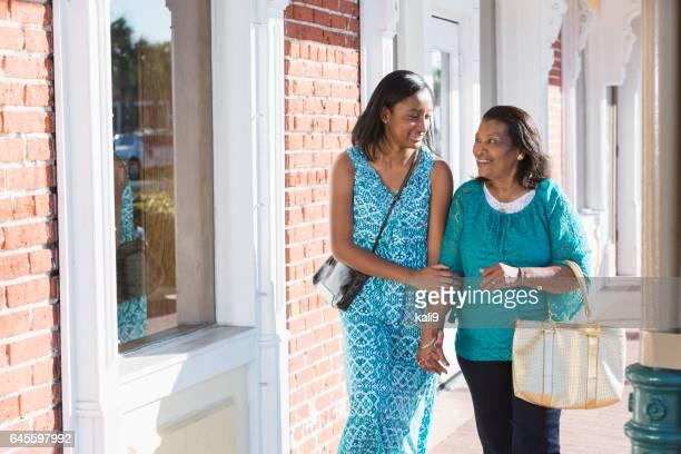 Black teenage girl walking with her grandmother