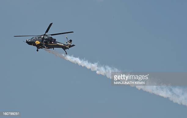 A HAL 'Black Tiger' Light Combat Helicopter currently under development for the Indian armed forces performs during Aero India 2013 at the Yelahanka...