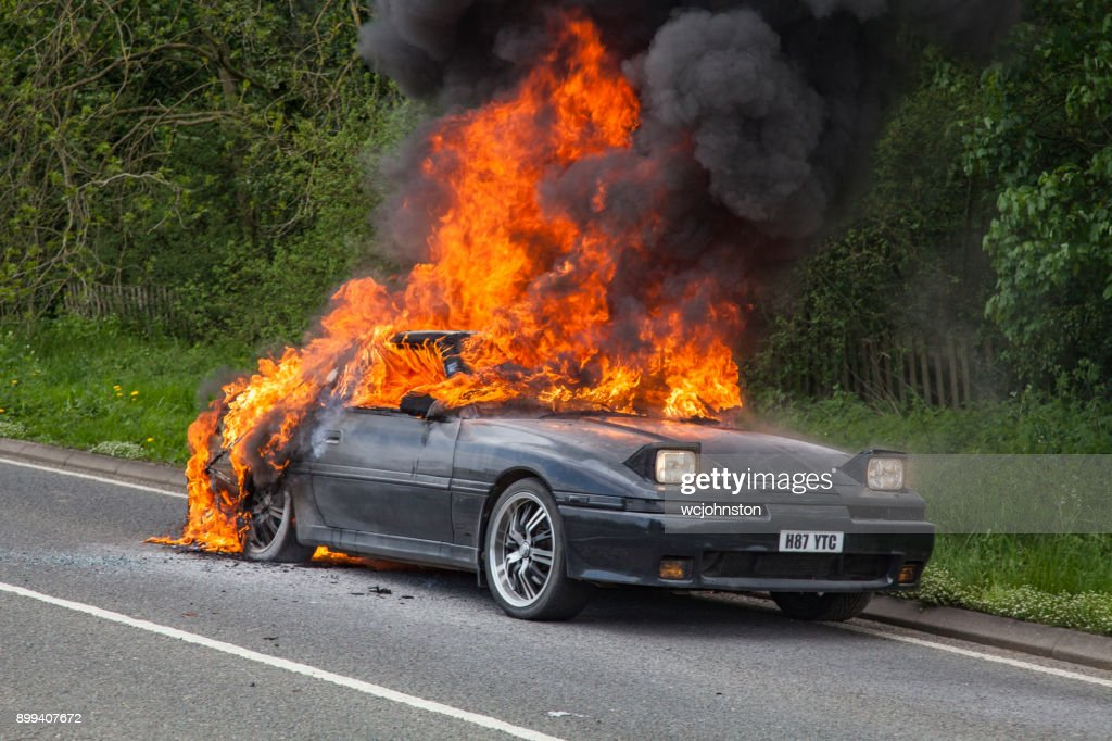 Black Toyota Supra Turbo Car On Fire : Stock Photo