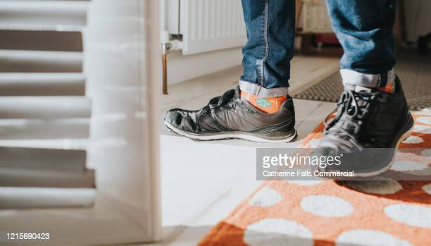 black trainers - building entrance stock pictures, royalty-free photos & images