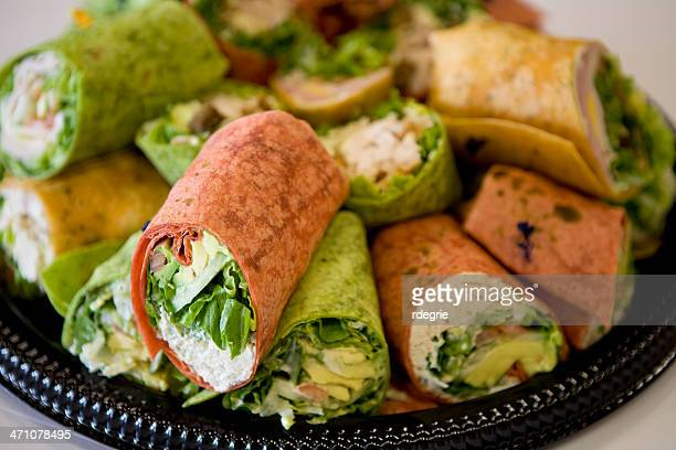 black tray full of rolled sandwiches with colored tortillas - tray stock pictures, royalty-free photos & images