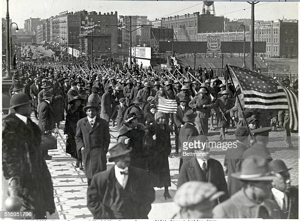 Negro troops of World War I parade over 145th Street bridge from Lenox Avenue Undated photograph
