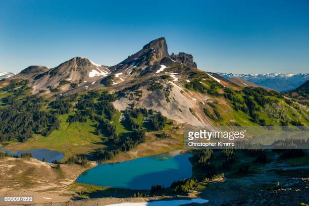 black tusk mountain, black tusk lake, helm lakes, and helm meadows in garibaldi provincial park, british columbia, canada. - garibaldi park stock pictures, royalty-free photos & images