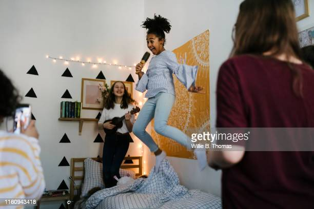 black tween jumping in the air - pre adolescent child stock pictures, royalty-free photos & images
