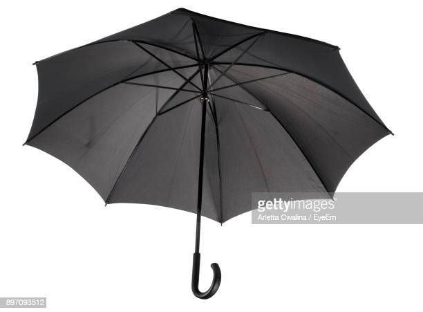 black umbrella against white background - umbrella stock pictures, royalty-free photos & images