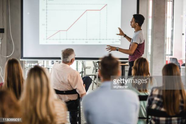 black university student giving a presentation during an education event. - projection screen stock pictures, royalty-free photos & images