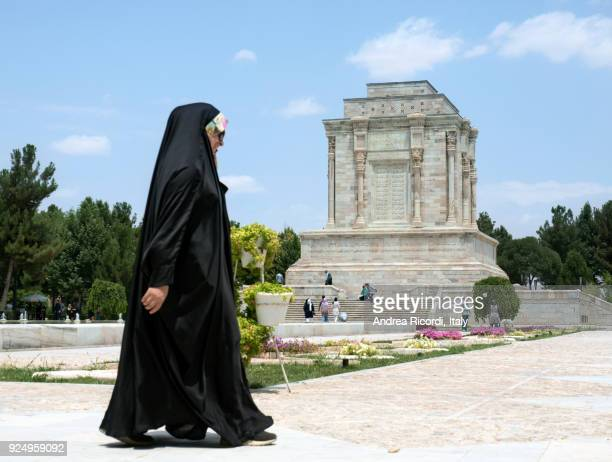 Black veiled woman passing by Ferdowsi tomb, Iran
