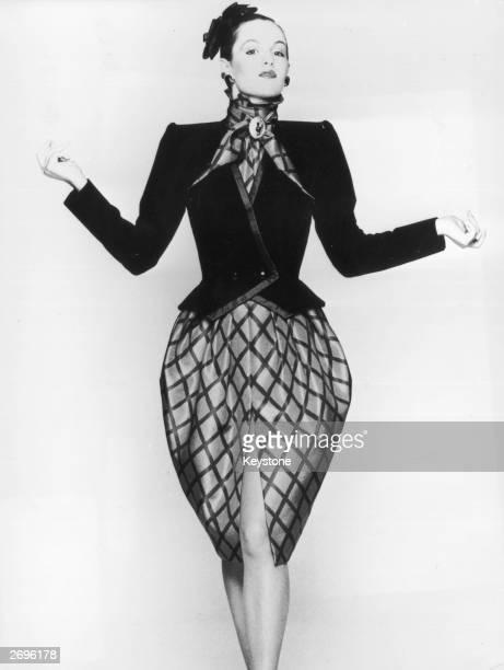 A black velvet jacket worn over a taffeta trellis print dress designed by Marc Bohan for the Dior collection