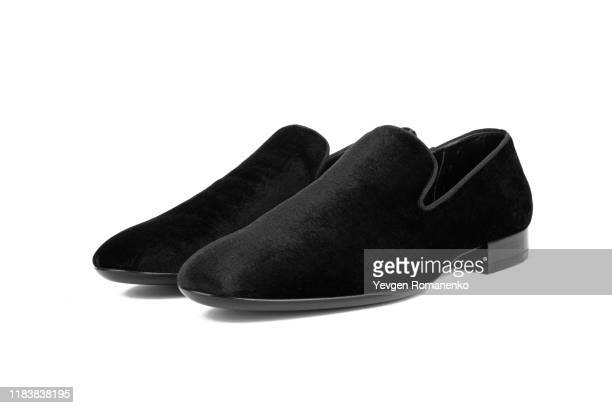black velvet loafer shoes on white background - loafers stock pictures, royalty-free photos & images