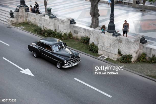 Black vintage car Taxi at street of Prado Havana, Cuba