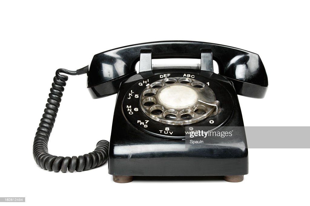 A black vintage rotary dial telephone : Stock Photo