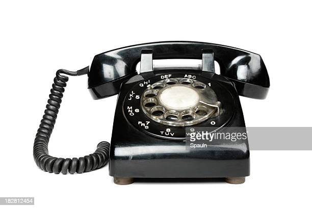 a black vintage rotary dial telephone - obsolete stock pictures, royalty-free photos & images