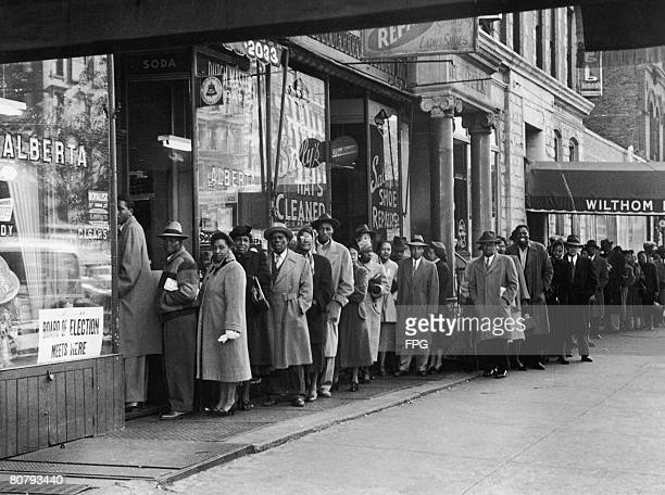 Black voters queuing to cast their ballot in New York's Harlem 1954