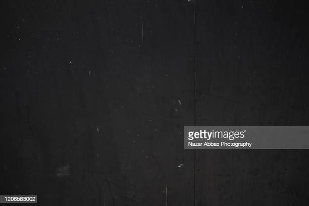 black wall background. - schwarz farbe stock-fotos und bilder
